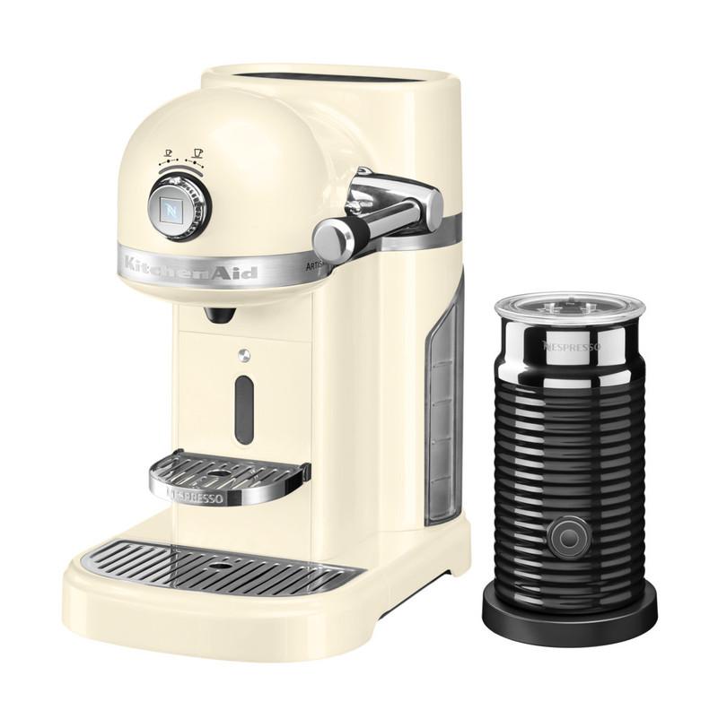 Кофеварка капсульная Artisan Nespresso + Aeroccino, кремовая, 5KES0504EAC, KitchenAidКофемашины Nespresso<br>Капсульная кофеварка Artisan Nespresso с устройством для взбивания молока Aeroccino сочетает в себе легендарный дизайн экстра-класса от KitchenAid и инновационную технологию (система высокого давления 19 бар), гарантирующую ни с чем не сравнимое качество кофе от Nespresso!&#13;<br>Кофе в капсулах Nespresso находится на пике популярности с момента своего появления. Качественный молотый кофе с лучших плантаций Бразилии, Америки и Африки тщательно подготовленный к приготовлению, высоко оценивается кофейными экспертами с мировым именем.&#13;<br>Особенности и преимущества:&#13;<br>&#13;<br>Кофеварка оснащена мощным нагревательным элементом из нержавеющей стали, поэтому требуется всего 25 секунд, чтобы вода в резервуаре достигла оптимальной температуры.&#13;<br>Насос высокого давления (19 бар) извлекает из кофейной капсулы максимум вкуса и аромата и создаёт плотную, высокую пенку «крем?» - первый признак отличного эспрессо.&#13;<br>Встроенный резервуар для воды объёмом 1,4 литра позволяет приготовить вкусный, ароматный кофе для большой компании.&#13;<br>Кофеварка имеет переключатель выбора объёма чашки, который позволяет выбрать 1 из 6 имеющихся вариантов – 25, 40, 60, 90, 110, 130 мл. Исходя из ваших предпочтений кофеварка программирует и сохраняет часто используемый вами вариант.&#13;<br>Автоматическое отключение после завершения цикла приготовления.&#13;<br>Для удобства использования кофеварка оборудована встроенным выдвижным лотком для сбора воды, а также поддоном для чашек.&#13;<br>Цельнометаллический корпус не боится физического воздействия, царапин, пятен.&#13;<br>Доступна в 6 фирменных цветах KitchenAid: красный, карамельное яблоко, кремовый, морозный жемчуг, серебряный медальон, чёрный.&#13;<br>&#13;<br>Дополнительные функции:&#13;<br>Автономный сборный резервуар кофемашины Nespresso отделяет до 14 использованных капсул от остатков воды для оптимальной их 