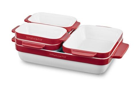 Набор керамических кастрюль (5 шт.), красный, KBLR05SBER, KitchenAidКерамическая посуда<br>Новинка 2017 года – универсальный набор кастрюль для выпечки и запекания из жаропрочной керамики непременно займет достойное место на вашей кухне!&#13;<br>Яркие и вдохновляющие&#13;<br>Керамические кастрюльки KitchenAid снаружи покрыты слоем цветной глазури, оттенок которой подойдет к любому стилю кухни. Внутренняя поверхность покрыта белой непористой глазурью, которая не впитывает запахи, не меняет цвет и не взаимодействует с продуктами.&#13;<br>Удобные ручки&#13;<br>Широкие ручки кастрюлек составляют одно целое с корпусом, поэтому держать кастрюлю удобно, и можно не бояться, что она выскользнет из рук. Безопасно доставайте готовые блюда из духовки и несите прямо к столу!&#13;<br>Множество применений&#13;<br>Керамическая посуда KitchenAid подходит для выпечки, запекания, сервировки блюд. Она не боится заморозки, безопасна для микроволновой печи и подходит для мытья в посудомоечной машине. Кастрюли выдерживают нагрев до 260 оС.&#13;<br>Компактное хранение&#13;<br>Благодаря эргономичному дизайну этот набор посуды не займет много места на вашей кухне. Кастрюли при хранении вкладываются одна в другую, аккуратно и практично.<br>