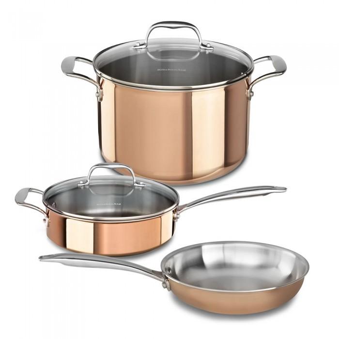 Набор посуды из 3 предметов, медь, KitchenAid3-слойная медная посуда<br>В набор входят:&#13;<br>&#13;<br>Сковорода KitchenAid, D25.4см (3 Ply Copper), медь&#13;<br>Сотейник KitchenAid, 3.31л с крышкой (3 Ply Copper), медь&#13;<br>Кастрюля KitchenAid для соуса, 2.84л с крышкой (3 Ply Copper), медь&#13;<br>&#13;<br>Особенности:&#13;<br>&#13;<br>3-слойные стенки из нержавеющей стали, алюминия и меди обеспечивают высокую теплопроводность&#13;<br>Основание из нержавеющей стали гарантирует прочность и подходит для всех типов варочных поверхностей&#13;<br>Сварная рукоятка из нержавеющей стали с логотипом бренда&#13;<br>Отметки уровня жидкости на внутренней поверхности кастрюли&#13;<br>Крышка из закаленного стекла&#13;<br>Разрешен нагрев до 260°С и использование в духовом шкафу&#13;<br>Не разрешается мыть в посудомоечной машине.&#13;<br><br>